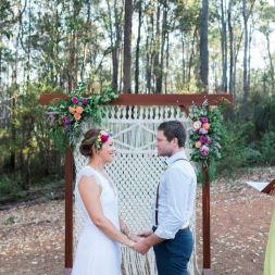 Macramé Backdrop $150.00. With Wooden Arbor $250.