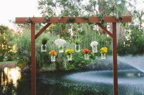 Wooden Arbor with hanging jars $150