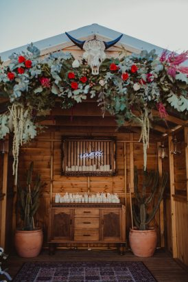 boho floral wedding arbour with bull skull
